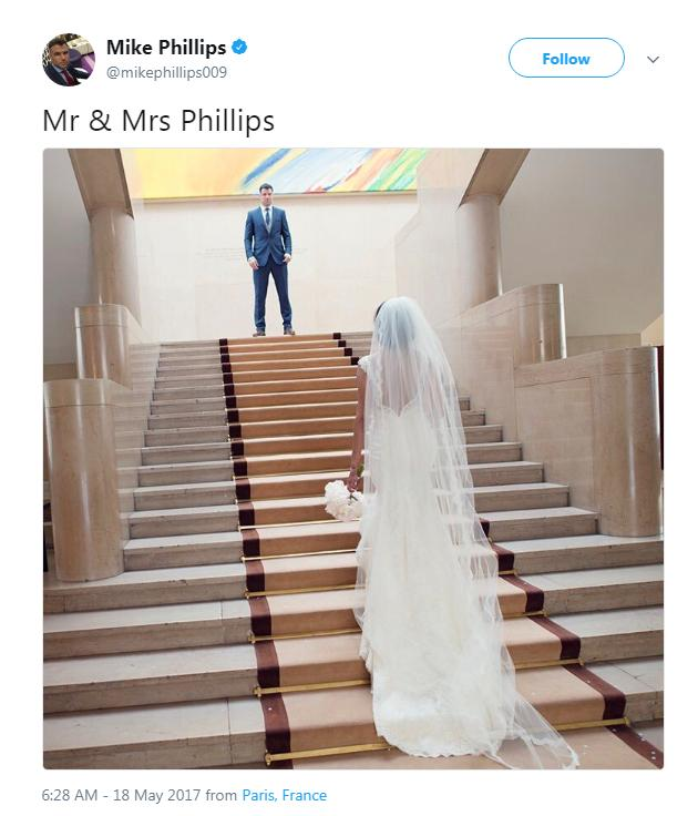 Mike Phillips on the top of the stairs, his wife in her wedding dress at the bottom